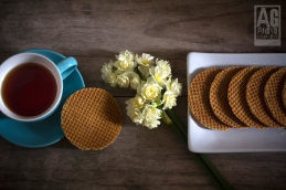Dutch Waffles (Stroop Wafels) with a Cup of Tea and Flowers