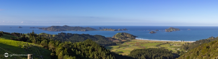 Panorama of Matauri Bay and Cavalli Islands, Northland, New Zealand on Bright Sunny Afternoon from Roadside Lookout Point
