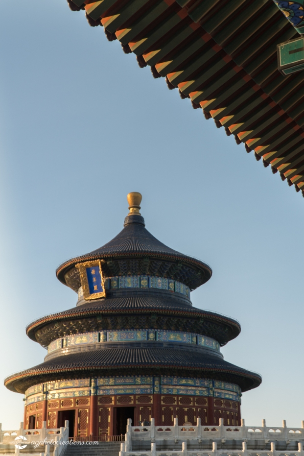 "Side shot of the Temple of Heaven on a Sunny Afternoon in Beijing China with inscription ""Hall of Prayer for Good Harvest"" - Vertical"