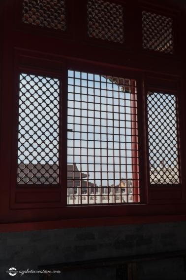Lattice Window Looking Over the Forbidden City Beijing China