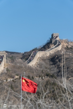 Badaling Section of the Great Wall of China in Winter with Chinese Flag in Foreground - Vertical