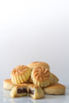 Middle Eastern Eid Cookies Filled with Dates in a Stack on Light Background Copy Space Vertical