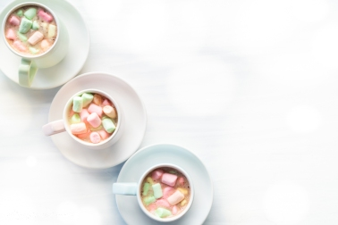 Hot Chocolate with Rainbow Marshmallows From Above with Copy Space