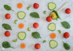 Pattern of Salad Ingredients on Marble Bench Top, Baby Spinach Leaves, Carrot, Cherry Tomatoes, Celery and Cucumber with a Combination of them on a Fork